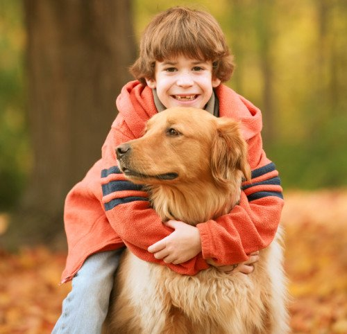 older-boy-hugging-dog
